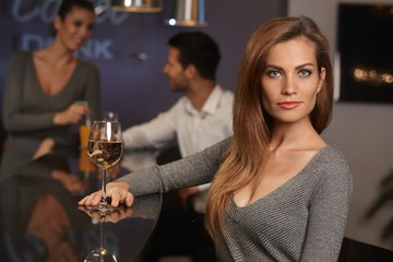 Portrait of beautiful young woman in bar