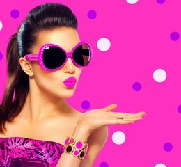 Beauty fashion model girl wearing purple sunglasses