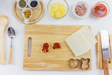 Ingredients for cooking pizza cartoon on wooden table, top view