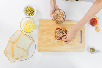 Sandwich bread, Butter and butter knife on wooden table. Top vie