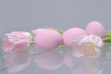 Pastel pink Easter eggs and tulips