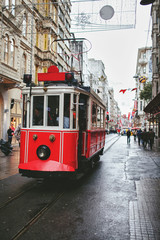red old tram rides through the streets of Istanbul