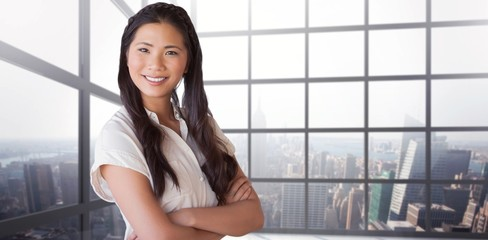 Composite image of casual businesswoman looking at camera