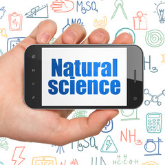 Science concept: Hand Holding Smartphone with Natural Science on display