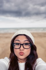 Composite image of asian woman making faces