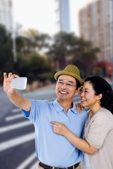 Composite image of man and woman taking a picture