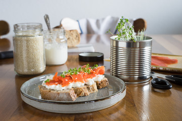 Salmon and cottage cheese sandwich served with garden cress. Selective focus.