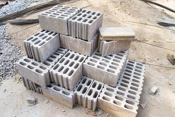 Bricks made of concrete for building of houses and fences