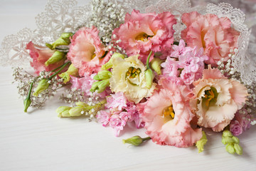 Flowers bouquet of pink hyacinths and lisianthus