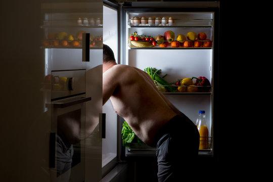 midnight snack, looking into fridge
