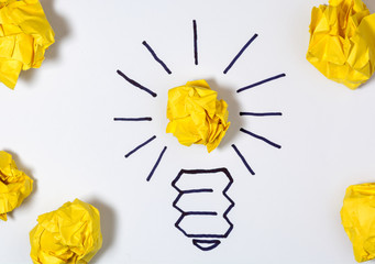 Concept for innovation, creativity and inspiration. Sketch of a light bulb with a paper ball