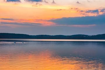 Lake landscape at colorful sunset