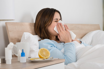 Woman Infected With Cold Lying On Bed