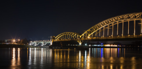 Cologne, Germany - March 11, 2016: Cologne Rheinauhafen at night showing a rhine bridge