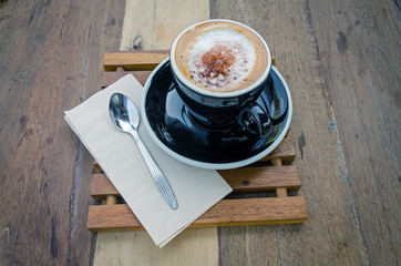 black coffee cup on wood table