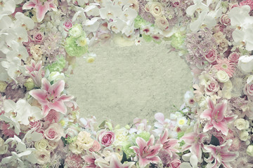 Pastel toned vintage background of flowers form a circle with rustic background