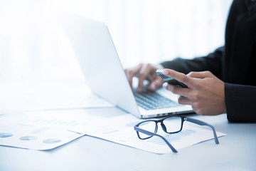 Glasses on the table of businessmen. He is working