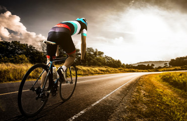 Men cycling road bike in the morning Wall mural