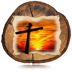 Jesus Cross at Sunset on Tree Trunk / Cross silhouette at the beautiful sunset in a old parchment. On a section of tree trunk and isolated on white background