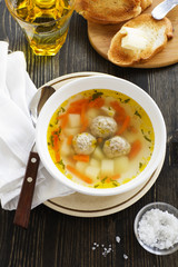 Chicken soup with meatballs.