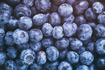 fresh blueberries top view background, vintage toned