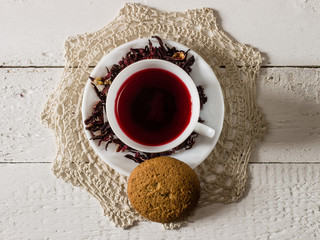 Cup of Karkadeh Red Tea with Dry Flowers and cookies