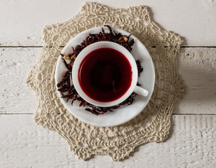 Cup of Karkadeh Red Tea with Dry Flowers
