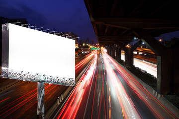 Blank billboard on night street with moving cars - can advertisement for display or montage your products or your business.