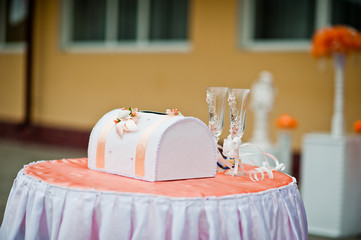 Small pink satin wedding table with box for money and two weddin