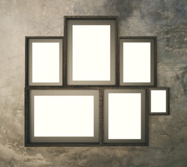 Brown broad pattern wall with multiple blank picture frames, 3D