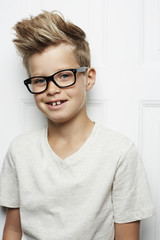 Spiky haired boy in t-shirt, smiling