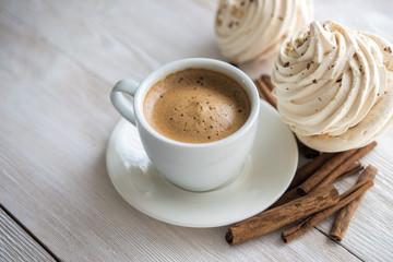 White cup of espresso coffee