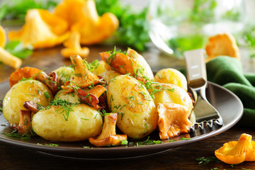 Fried potatoes with chanterelle mushrooms.