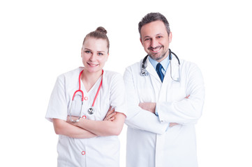 Portrait of two attractive experienced doctors standing with arm
