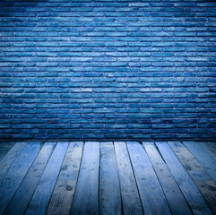 brickwall with wooden table under blue light