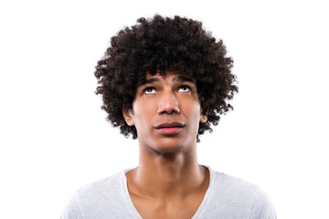 Man with afro hair looking up