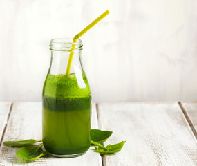 Apple and spinach juice in bottle
