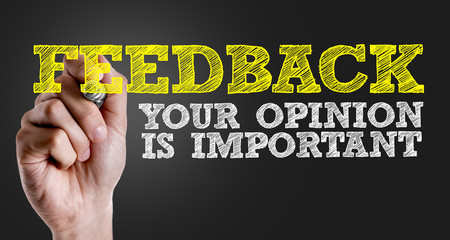 Hand writing the text: Feedback - Your Opinion Is Important Wall mural