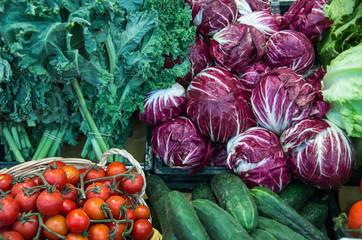 tomatoes; cucumbers; salad; lettuce; radicchio;