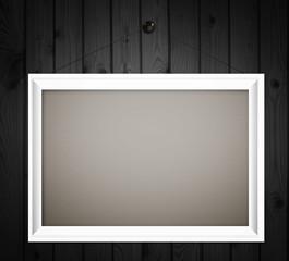 white frame on dark wood wall background