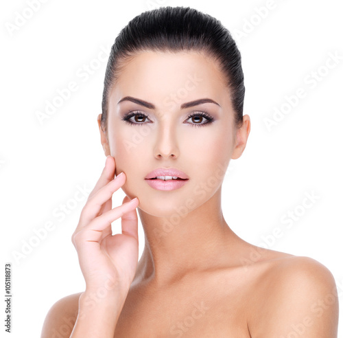 Wall mural Beautiful face of young girl  with  fresh healthy skin