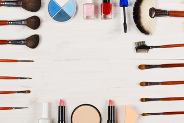 Various makeup products on white  background with copyspace