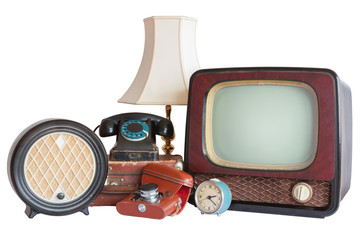 Old household items: TV, radio, camera, alarm, phone, table lamp