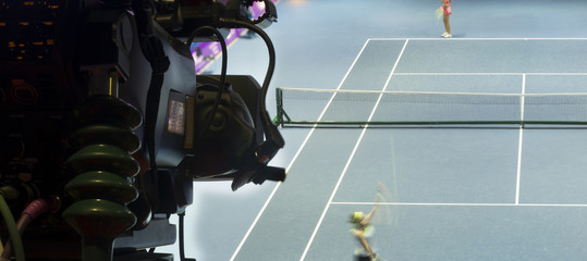 Professional digital video camera. accessories for 4k video cameras. tv camera in a tennis hall.