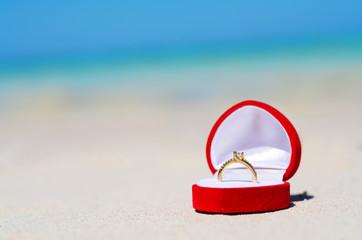 Wedding ring on the beach