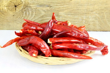 red chili pepper in bamboo basket