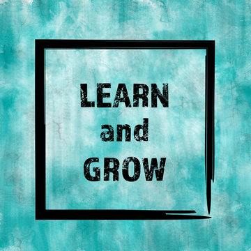 Learn and grow message on vintage blue painted background
