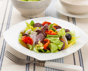 Mixed salad with black pudding sausage