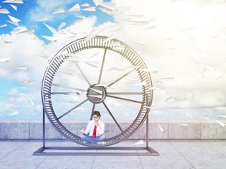 Man in spinning wheel