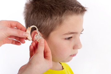 Hearing aid inserting